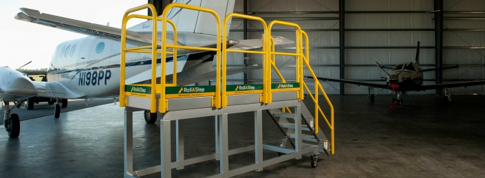 Standard MP rolling work platform to work on small jets and prop planes 705x259 Rolling Stairs and Work Platforms